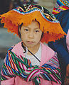 Indian girl with big hat Peru.jpg