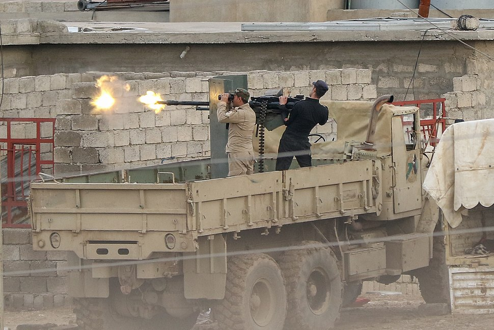 Iraqi Army fire a heavy machine at ISIS positions in Mosul