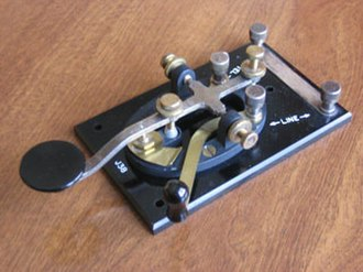 "Morse code - Typical ""straight key"". This U.S. model J-38, was manufactured in huge quantities during World War II. The signal is ""on"" when the knob is pressed, and ""off"" when it is released. Length and timing of the dots and dashes are entirely controlled by the telegraphist."
