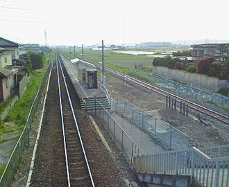 Naganawashiro Station - The station in May 2007 viewed from the Route 104 overpass to the east of the station. The Hachinohe Rinkai Railway lies behind the platform.