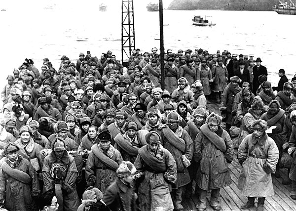 Japanese prisoners released from Soviet captivity in Siberia prepare to disembark from a ship docked at Maizuru, Japan, January 1946. Japanese Soldiers Returning from Siberia 1946.jpg