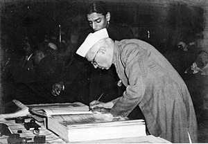 Constitution of India - Jawaharlal Nehru signing the Constitution