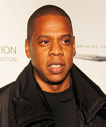 "Jay-Z amassed three number-one singles, including the concluding number one of the decade ""Empire State of Mind"" featuring Alicia Keys. Jay-Z @ Shawn 'Jay-Z' Carter Foundation Carnival (crop 2).jpg"