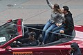 Jim Harbaugh drives Brandon Belt at 2012 World Series victory parade (cropped).jpg