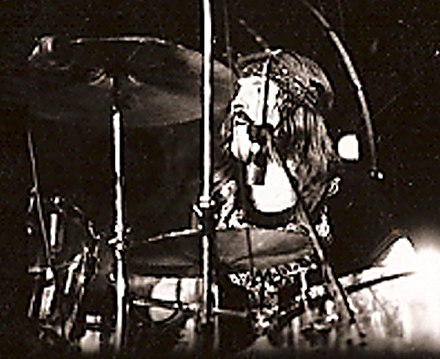 John Bonham, on stage in the US in 1973, whose aggressive drumming style was critical to the hard rock sound associated with the band John Bonham-2cropped.jpg