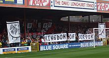 One of the stands of the Bootham Crescent association football ground, with holding up banners