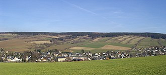 Waldhufendorf - Königswalde is one of the most striking Waldhufendörfer in the Ore Mountains due to the stone ridges that have been preserved which mark the boundaries of the field strips