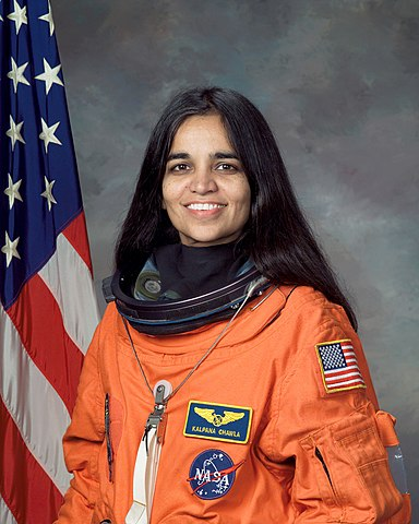 Astronaut Kalpana Chawla, NASA photo Source: Wikipedia (spaceflight.nasa.gov killed 25 Feb 2021) 384px-Kalpana_Chawla%2C_NASA_photo_portrait_in_orange_suit.jpg