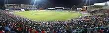 A panoramic view of a crowded sports stadium at night