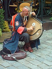 Street musician playing the bandura, a Ukrainian zither