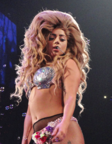 Lady Gaga performing in a seashell costume.