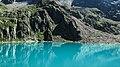 Lake by mossy mountain (Unsplash).jpg