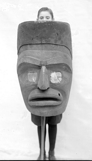 George Gustav Heye - Boy holding a very large Kwakiutl mask, Museum of the American Indian, circa 1920