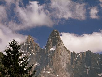 Aiguille du Dru - The north face of the Petit Dru (centre, with large snowpatch) in 2008. The west and south-west faces (with fresh rockfall scars) are to the right. The peak on the left is the Aiguille Verte.
