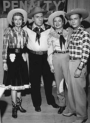 The Life of Riley - The Riley family.  From left: Lugene Sanders (Babs), William Bendix (Chester A. Riley), Marjorie Reynolds (Peg), and Wesley Morgan (Junior).