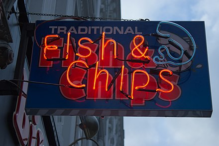 A neon sign for Fish and chips in London, England London England Victor Grigas 2011-37.jpg