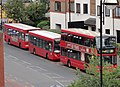 London Red Buses on a Stop in Grove Road in Hounslow - panoramio.jpg