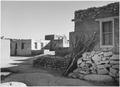 Looking across street toward houses, Acoma Pueblo (National Historic Landmark, New Mexico), 1933 - 1942 - NARA - 519836.tif