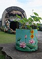 Lotus leaves outside the Ten Courts of Hell, Haw Par Villa (14607484087).jpg