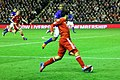 Luis Suarez runs at Distin 2.jpg
