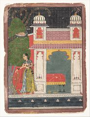 A Heroine Plucking a Flower:  Page from a Dispersed Nayikabheda
