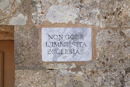 Plaque at St. Mary Magdalene Chapel, Dingli, Malta, indicating that the chapel did not enjoy ecclesiastical immunity