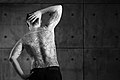 Man with a backpiece Christian and Enlightenment tattoo. Michael and the Dragon. Black and White.jpg