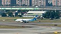 Mandarin Airlines Embraer 190 B-16822 on Final Approach at Taipei Songshan Airport 20150104d.jpg
