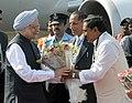 Manmohan Singh being received by the Governor, Andhra Pradesh, Shri E.S.L. Narasimhan and the Chief Minister of Andhra Pradesh, Shri N. Kiran Kumar Reddy, on his arrival, at Rajiv Gandhi International Airport, in Hyderabad.jpg