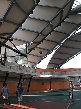 Marine Parade Community Building - The Marine Parade Community Building has a covered rooftop basketball court. The roof resembles the leaves of a palm tree.