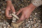 Marine leaves 'no rock unturned' creating deployment art 131124-M-ZB219-032.jpg