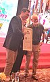 Marshall Goldsmith giving Nigel Cumberland an award as a top 100 global leadership coach.jpg