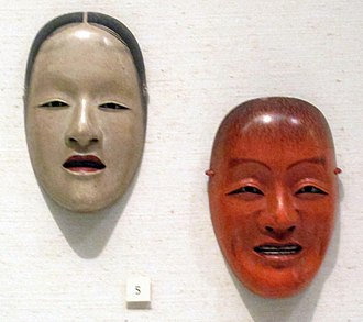 Noh - Nō masks. Right: Drunken spirit (shōjō). Made of red and black lacquered wood, with red silk tying cord, by Himi Munetada (氷見宗忠). Edo period, 19th century. Left: Nakizo, representing a female deity or woman of high rank, associated with Nō plays such as Hagoromo and Ohara Miyuki. Made of lacquered and painted wood by Norinari (憲成), designed by Zoami (増阿弥). 18th-19th century.