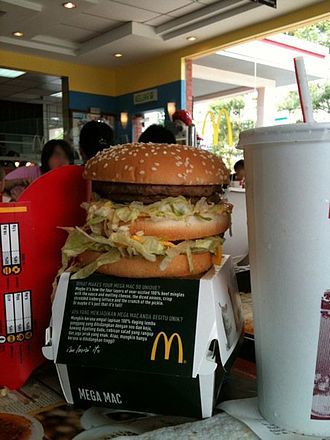 Big Mac - A Mega Mac burger with a large Coke and fries in Malaysia