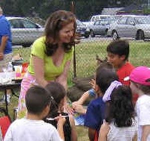 Michelle Ferguson-Cohen - Image: Michelle Ferguson Cohen and a group of children