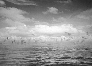 Mitsubishi G4M1 bombers fly low between Guadalcanal and Tulagi on 8 August 1942 (NH 97753).jpg