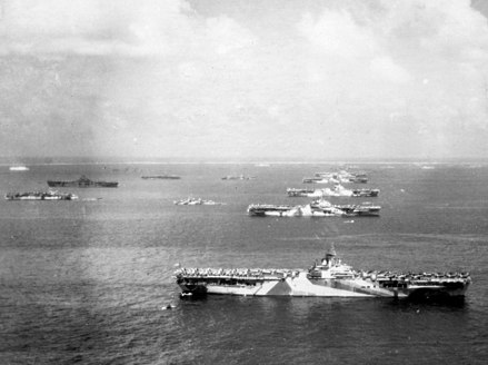 Several of the Third Fleet's aircraft carriers and other warships at Ulithi in early December 1944 Murderers row at Ulithi Atoll - US Third fleet carriers at anchor on 8 December 1944 (80-G-294131).jpg