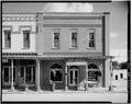 NORTH FRONT AND ADJACENT BUILDING TO EAST - Oliver-McDonald Company, Main Street, Plains, Sumter County, GA HABS GA,131-PLAIN,12-1.tif