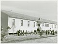Negro children playing outside of nursery at Okeechobee migr... (3109740925).jpg
