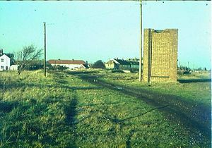 New Romney and Littlestone-on-Sea railway station - Station site in 1973, showing the base of the water tower to the right and the remains of one platform in the far distance.