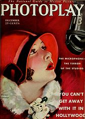 "Magazine cover with illustration of a young woman wearing a form-fitting red hat staring up at a suspended microphone. Accompanying text reads, ""The Microphone--The Terror of the Studios"", and, in larger type, ""You Can't Get Away With It in Hollywood""."