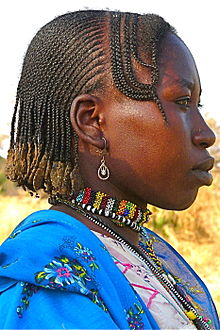 A Nuba Woman Wearing Cornrows In Traditional Styling