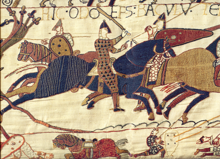Depiction of Bishop Odo (wielding club at centre) who imprisoned Henry from 1088-89. From the Bayeux Tapestry. Odo bayeux tapestry.png