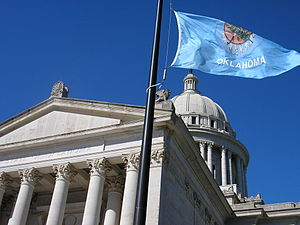 Flag of Oklahoma - The Oklahoman flag flying outside of the Oklahoma Capitol.