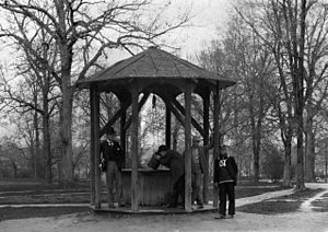 Old Well - The Old Well, here in a photo from 1892, served as the campus's sole water source for many years.