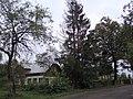 Old house at edge of Comanesti village - 3 - panoramio.jpg