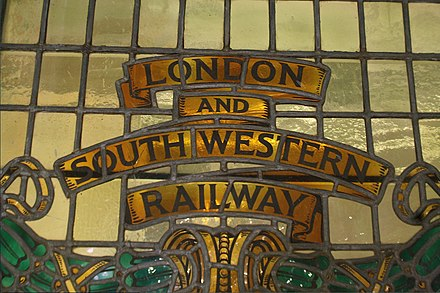 The early 20th-century reconstruction of Waterloo included a stained glass window with the London and South Western Railway's crest. Old railway company titles in London, 2013 - panoramio.jpg