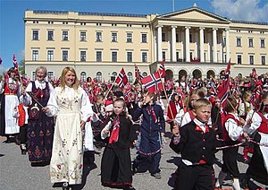 Norwegians dressed in bunad parading in front ...