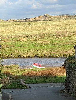 Painted in the national colours - a boat beached on the west bank of Afon Ffraw - geograph.org.uk - 1028708