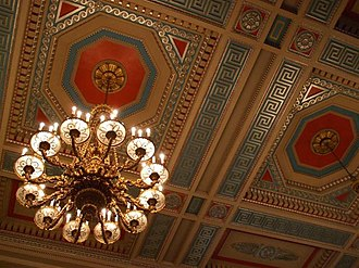 Parliament Buildings (Northern Ireland) - A grand chandelier, with the elaborate ceiling of the Great Hall.